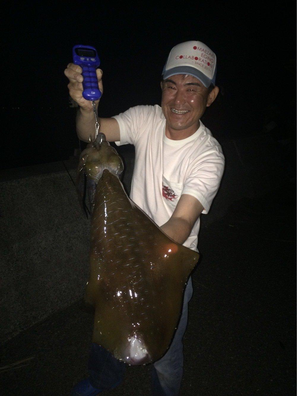 おけら大将さんの投稿画像,写っている魚はアオリイカ