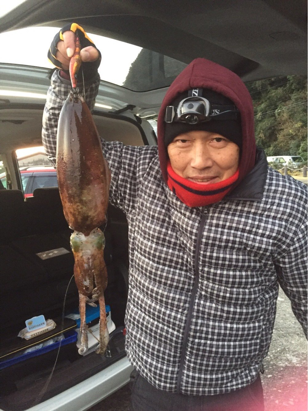英俊さんの投稿画像,写っている魚はアオリイカ